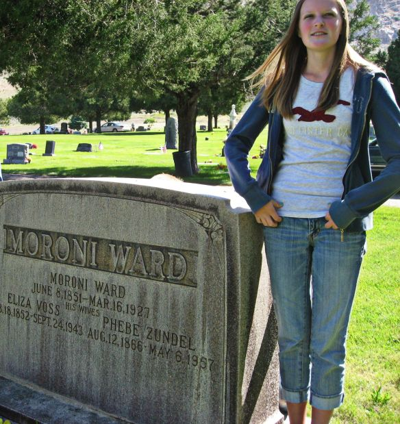My granddaughter, Phebe, standing by the headstone of the grandma Phebe Zundel Ward
