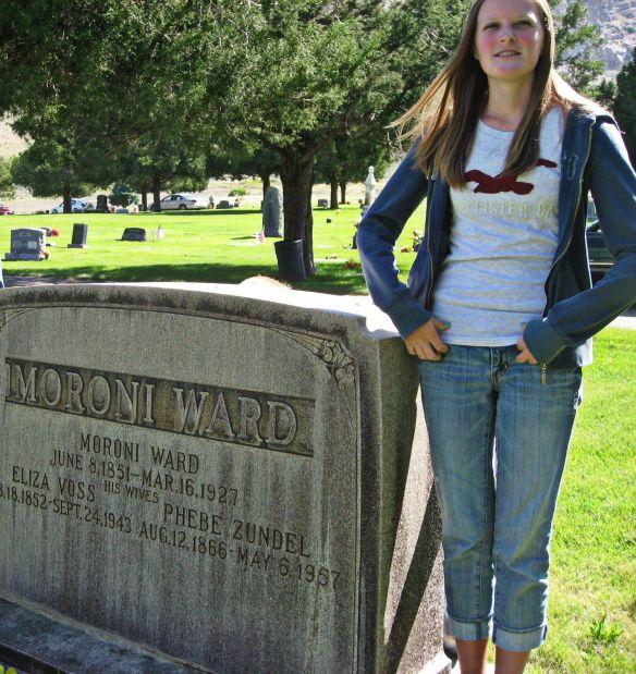 My granddaughter, Phebe, standing by the headstone of the grandma Phebe Zundel Ward